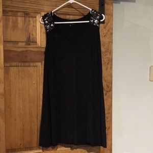 Short black sleeveless dress with bejeweled detail